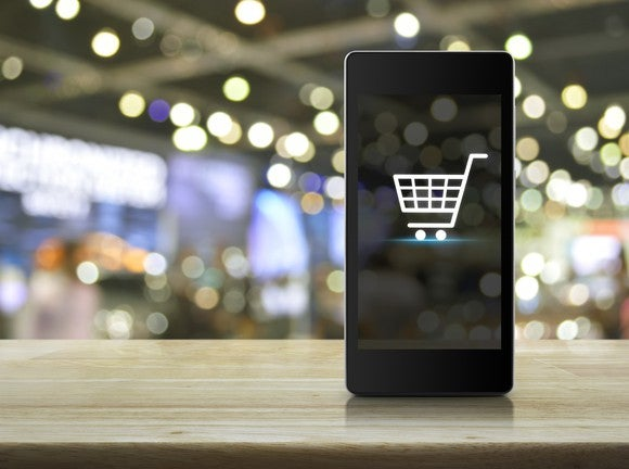 A smartphone showing an image of a shopping cart