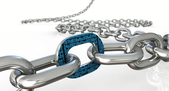 A long chain of steel links snaked across a white platform. Up close, one chain link is adorned with teal, hexadecimal numbers on a black background.