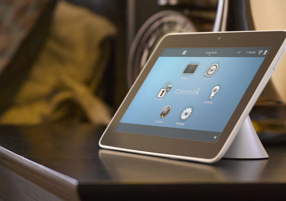 Tablet showing the Smart Home interface of Control4.