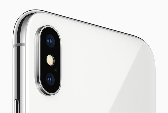 The rear-facing camera of the iPhone X in Silver.