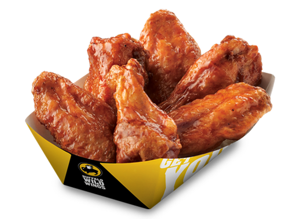 A basket of traditional chicken wings in a yellow Buffalo Wild Wings basket.