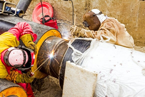 A team of welders working on a pipeline.