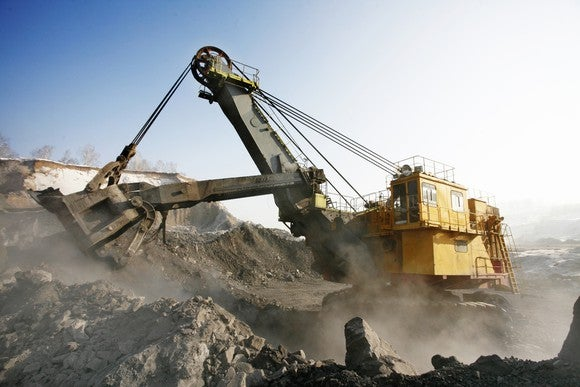 An industrial machine digging at a surface mine.