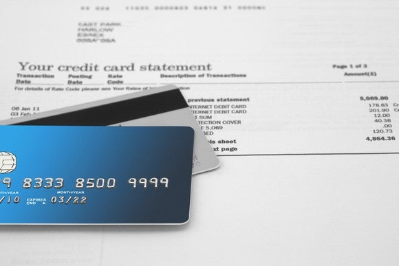 Credit cards resting on a credit card statement