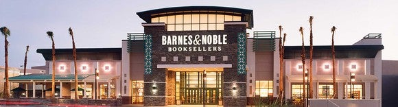 Barnes & Noble Booksellers location with palm trees in front.