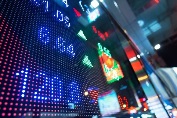 Display board at stock exchange showing stock prices.