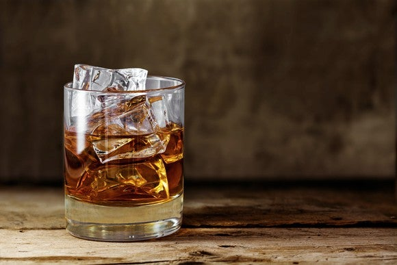 A glass of whiskey with ice.