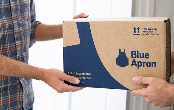 Blue Apron box being delivered