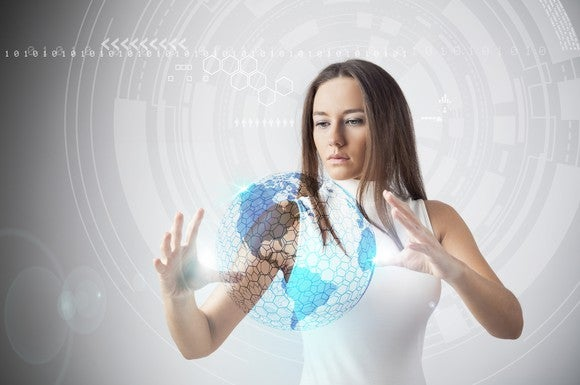 Woman moving an augmented reality world with her hands.