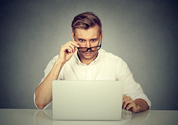 Man looking at computer with shocked expression