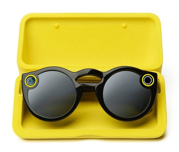 Custom Snap glasses in a yellow case.