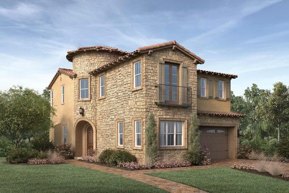 Luxury two-story house in stucco and stone siding with well-landscaped lawn and one-car garage.