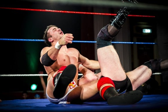 Two wrestlers in a ring