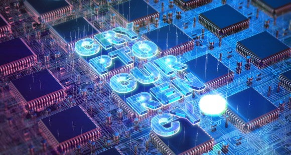 The word cryptocurrency written across a multiple ASIC chips and circuitry.