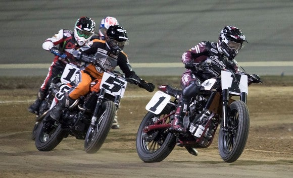 Indian Wrecking Crew member Bryan Smith racing on the track, with three other racers behind him.