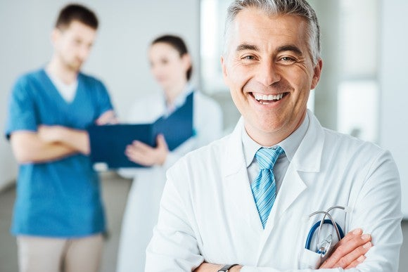 Smiling doctor with his arms crossed.