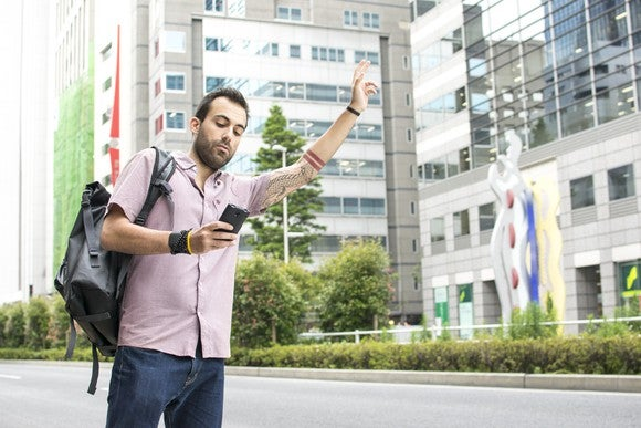 Man using smartphone for ridehailing