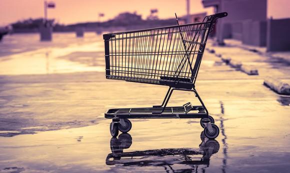 An empty shopping cart in an empty parking lot