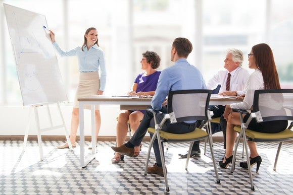 Professionals sitting through a presentation