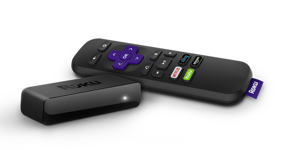 A Roku streaming player sitting next to a remote.