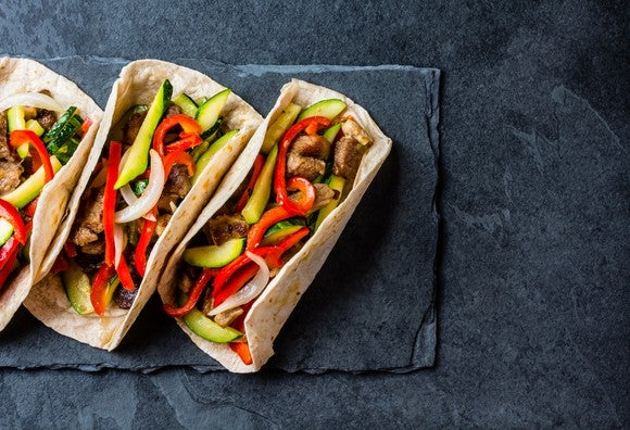 Tacos sitting on a table.
