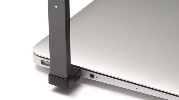 JUUL e-cig plugged into laptop