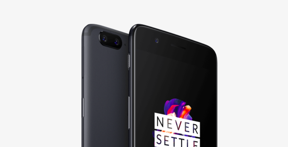 A close up of two OnePlus 5 devices shown with one facing backward and one facing forward with the words never settle on the screen.