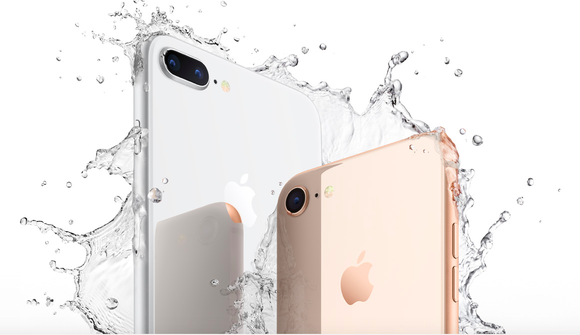 Two iPhone 8 devices are shown in an advertisement that features splashing water around the phones and a white background