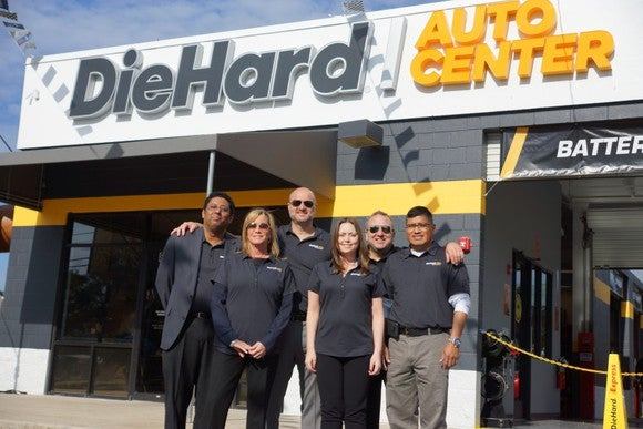 A Sears DieHard Auto Center store with six employees standing out front.