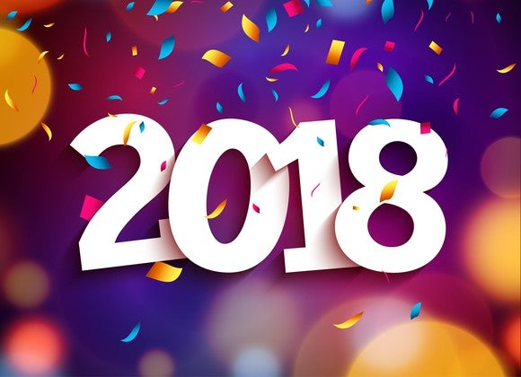 2018 in white letters on a background of colored circles and confetti