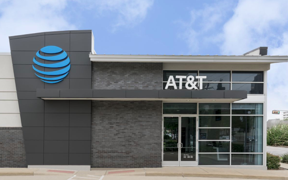 An AT&T retail storefront is shown with a blue sky in the background
