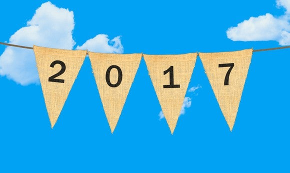"A horizontal rope with the year ""2017"" spelled out on four upside down triangle flags hanging from the rope."