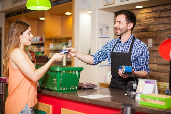 A clerk processes a customer's order.