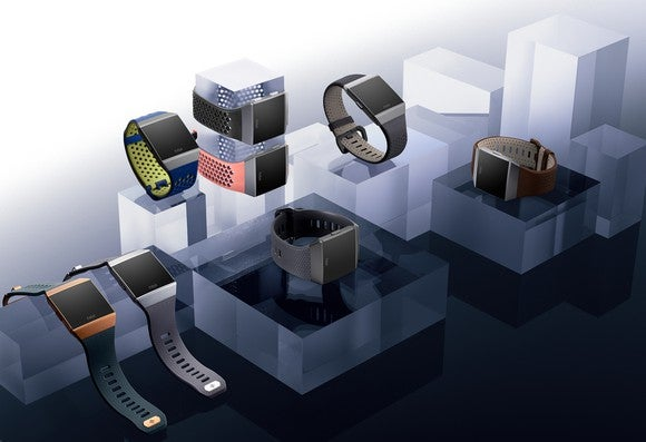 Fitbit smartwatches sitting on blocks.