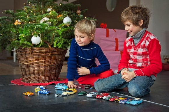 Two kids playing car games