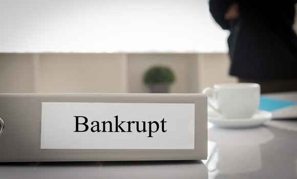 Binder labeled bankrupt