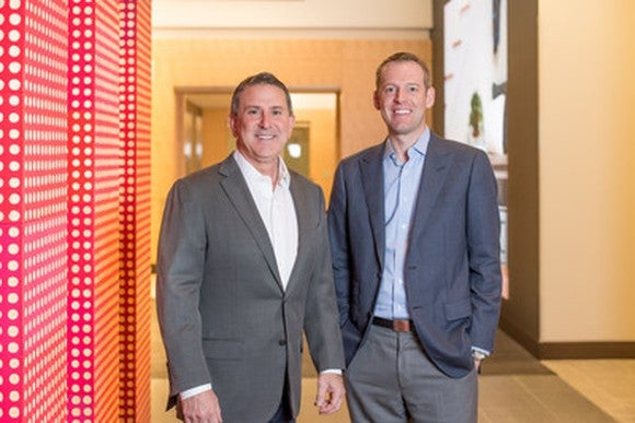 Target CEO Brian Cornell and Shipt CEO Bill Smith standing together in a hallway.