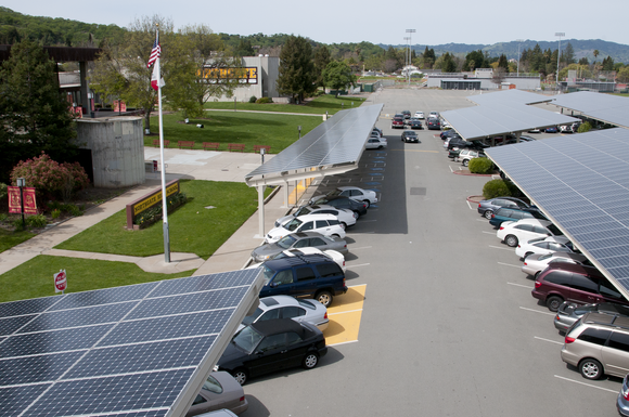 Carport with solar panels at a large parking lot.