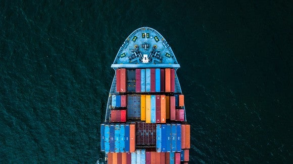 An overhead view of shipping containers on a sea vessel.