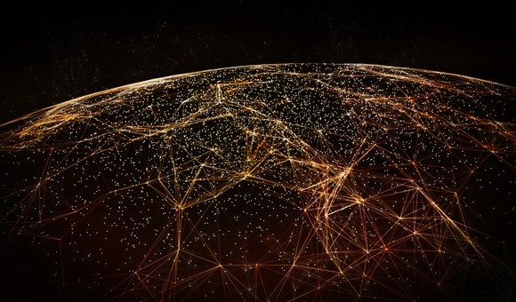 View of part of the world from space, darkened with orange connecting dots and lines