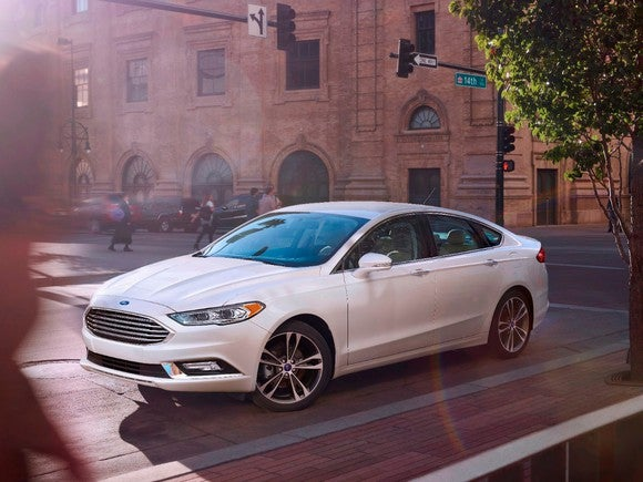 Ford's 2017 Fusion parked on a busy street.