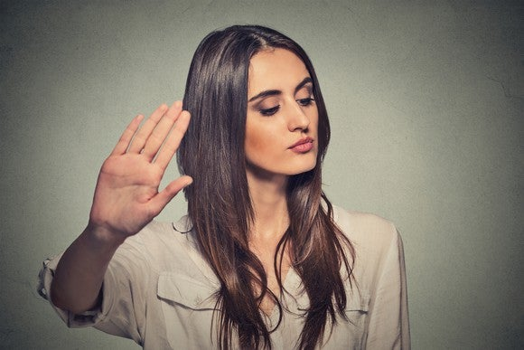angry woman with bad attitude giving talk to hand gesture