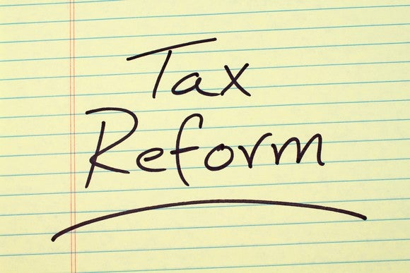 Tax reform written on a yellow legal pad