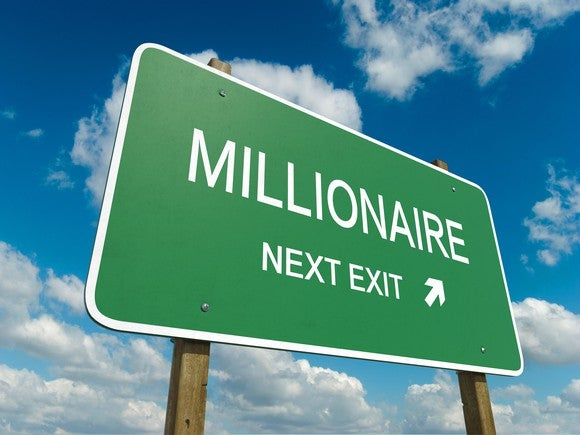 "A road sign pointing to millionaire with the words ""millionaire next exit."""