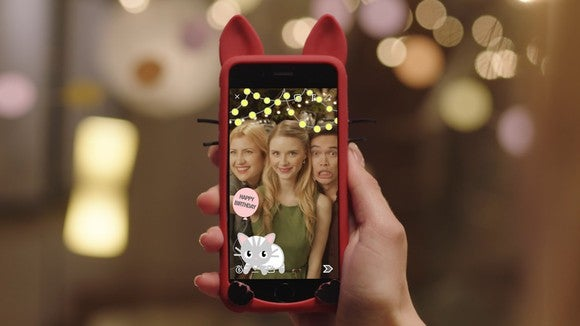 Snapchat's filters dolling up a holiday photograph on a smartphone.