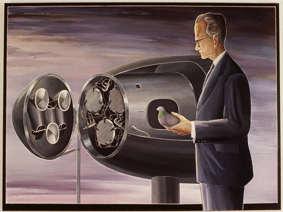 B.F. Skinner holding a pigeon next to a bomb with three miniature cockpits