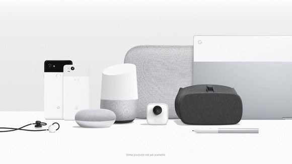 Google's Pixel hardware lineup. Two phones, a Pixelbook laptop, headphones, a pen, and various speaker and home assistants are displayed together.