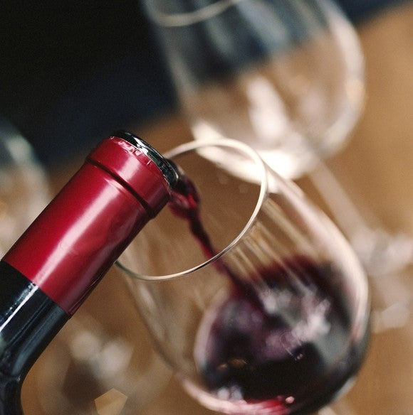 Red wine pouring into a glass.