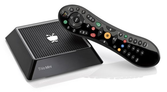 TiVo mini device with hand-held remote.