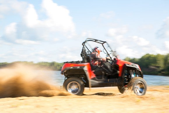 ATV riding on the sand during the day.